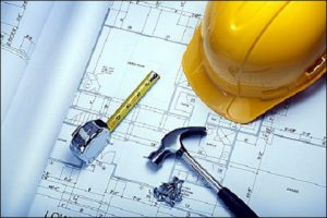 Contractor's Working tools: Helmet. Tape-rule, Hammer, clips and Architectural design paper