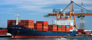 Cargo ship with container at the sea port. Copyright: Bing Image