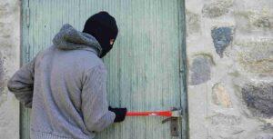 Burglar trying to break into an apartment