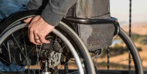 A patient on a wheelchair. Image Copyright: Pixabay