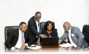 Universal Insurance Plc. Management in the Board Room discussing issues